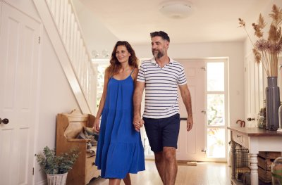 Couple Looking Around New Home Before They Move In